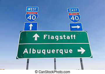 US Interstate I-40 road sign in Arizona with a sky blue background