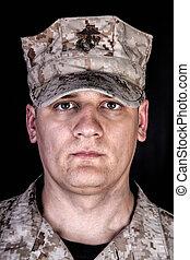 U.S. Marine in patrol cap studio portrait on black