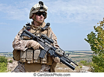 US marine - Close-up photo of US marine with his rifle