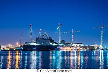 USS OAK HILL (LSD 51) at drydock in Norfolk Va. on the Elizabeth river. Taken just after sunset on December 1, 2012