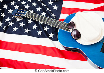 US pro musicians. Guitar lies on the flag of Britain. Glasses on