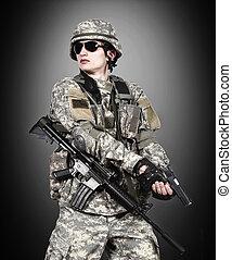 US soldier holding gun
