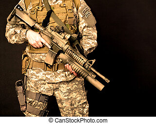 US soldier holding his assault rifle