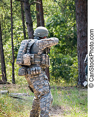 US Soldier - The US Army soldier on position shooting the...