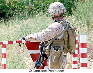 us soldier with assault rifle at the checkpoint