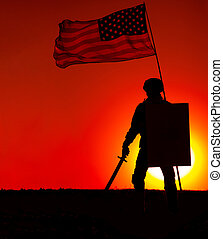 US soldier with shield and sword under waving flag