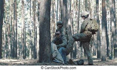 US soldiers interrogate militant LIH.