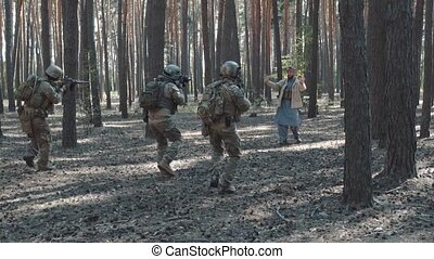 US soldiers take captive militant LIH.