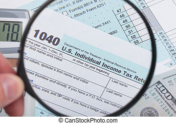USA 1040 Tax Form with magnifying glass