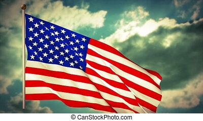 USA American Flag waving on a blue cloudy sky