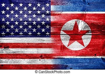 USA and North Korea Flag painted on old wood plank texture