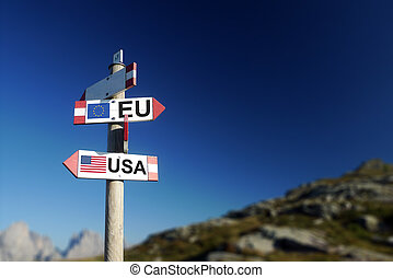 USA and UE flags on mountain signpost. - European and ...