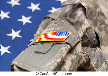 USA army uniform over national flag - studio shot - USA army...