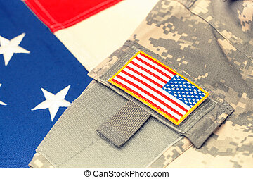 USA army uniform with chevron over flag - focus on chevron -...