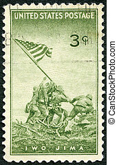 USA - CIRCA 1945 : A stamp printed in the USA shows Marines Raising the Flag on Mount Suribachi, Iwo Jima, from a Photograph by Joel Rosenthal, Achievements of the U.S. Marines in WWII, circa 1945