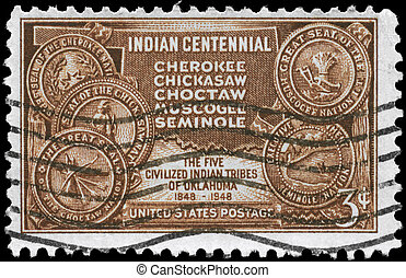 USA - CIRCA 1948: A Stamp printed in USA shows the Map of Indian Territory & Seals of five Tribes, centennial issue, circa 1948