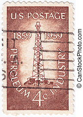 USA - CIRCA 1959 :  stamp printed in USA show Petroleum Industry with first oil well at Titusville, Pennsylvania, circa 1959