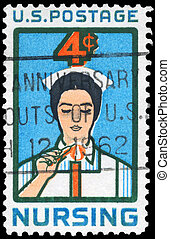 USA - CIRCA 1961: A Stamp printed in USA shows a Student Nurse lighting Candle, Nursing Issue, circa 1961