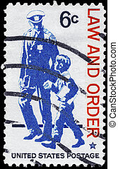 USA - CIRCA 1968: A Stamp printed in USA shows Policeman and small Boy, Law and Order Issue, circa 1968