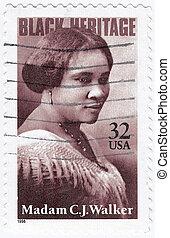 USA - CIRCA 1998 : stamp printed in USA show Madam C. J. Walker African-American businesswoman, circa 1998