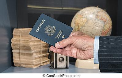 USA Citizen with passport and world globe and camera