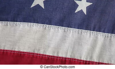 American flag blowing in a breeze