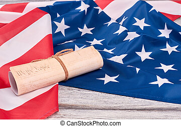 USA flag and ancient manuscript.