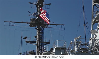 USA flag and antennas on carrier