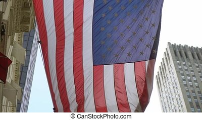 USA flag at building in a city