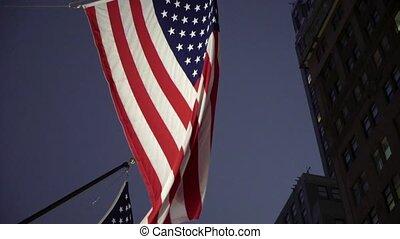 USA flag at night city