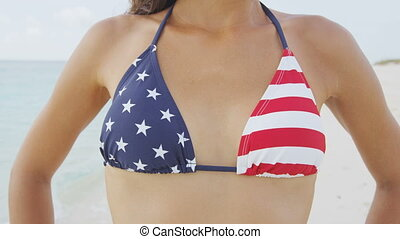 USA flag bikini top closeup of sexy beach body woman wearing american style swimwear. Star and stripes pattern. United states clothing.