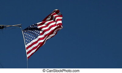 USA flag flying on the wind on blue