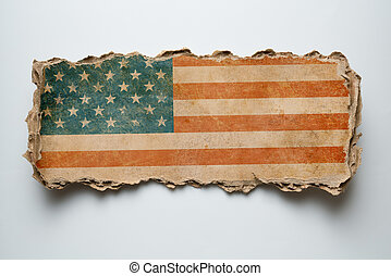 USA flag on torn cardboard