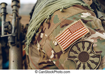USA flag patch on military uniform of american soldier