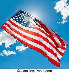USA flag waving on blue sky background - 1 to 1 ratio