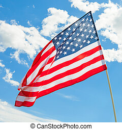USA flag waving on blue sky background - outdoors shoot - 1 to 1 ratio