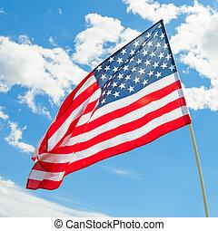 USA flag waving on blue sky background - outdoors shoot - 1 to 1 ratio