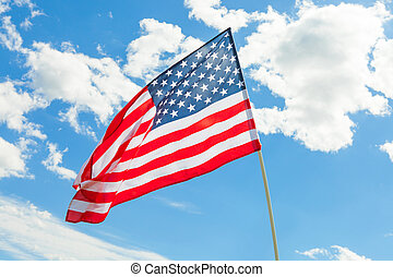 USA flag waving on blue sky background - outdoors shoot