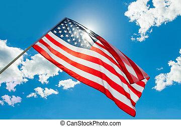 USA flag waving on blue sky background