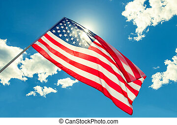 USA flag with clouds on background
