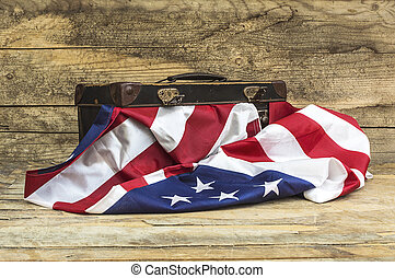 USA flag with old style voyage suitcase.