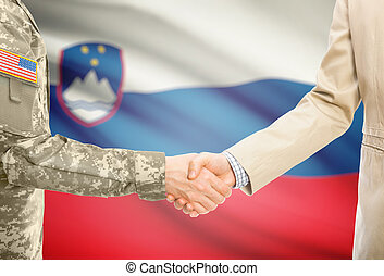 USA military man in uniform and civil man in suit shaking ...