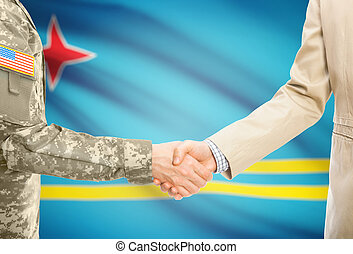 USA military man in uniform and civil man in suit shaking hands with national flag on background - Aruba
