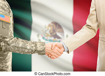 USA military man in uniform and civil man in suit shaking hands with national flag on background - Mexico