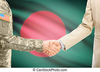USA military man in uniform and civil man in suit shaking hands with national flag on background - Bangladesh