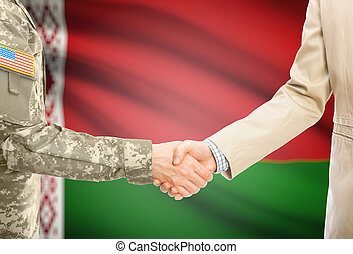 USA military man in uniform and civil man in suit shaking hands with national flag on background - Belarus