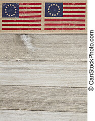 USA patriotic Betsy Ross old flag on a weathered wood...