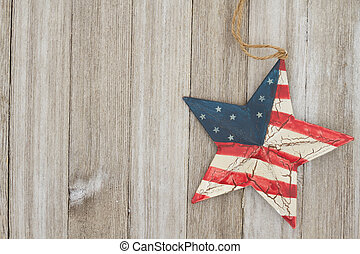 USA patriotic old flag on a star and weathered wood background