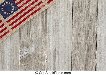 USA patriotic old flag on a weathered wood background