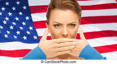 woman with hands over mouth